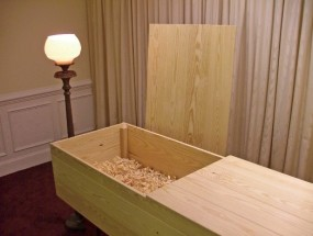 Handcrafted pine coffin with pine shavings  from Piedmont Pine Coffins