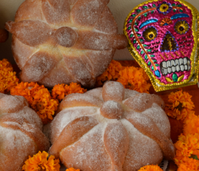 Day of the Dead bread and a sugar skull ornament