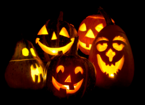 Five glowing carved jackolanterns